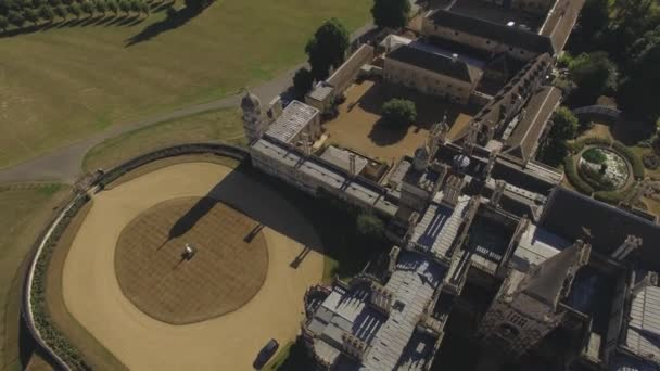 Aerial drone shot of Burghley House, a grand sixteenth-century country house,  surrounding countryside in England