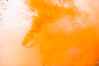 portrait of military girl outdoor of orange smoke