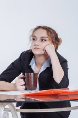 Tired woman feeling pain after sedentary computer work in uncomfortable posture or office chair, exhausted female student or employee leaned on the table, sitting at workplace