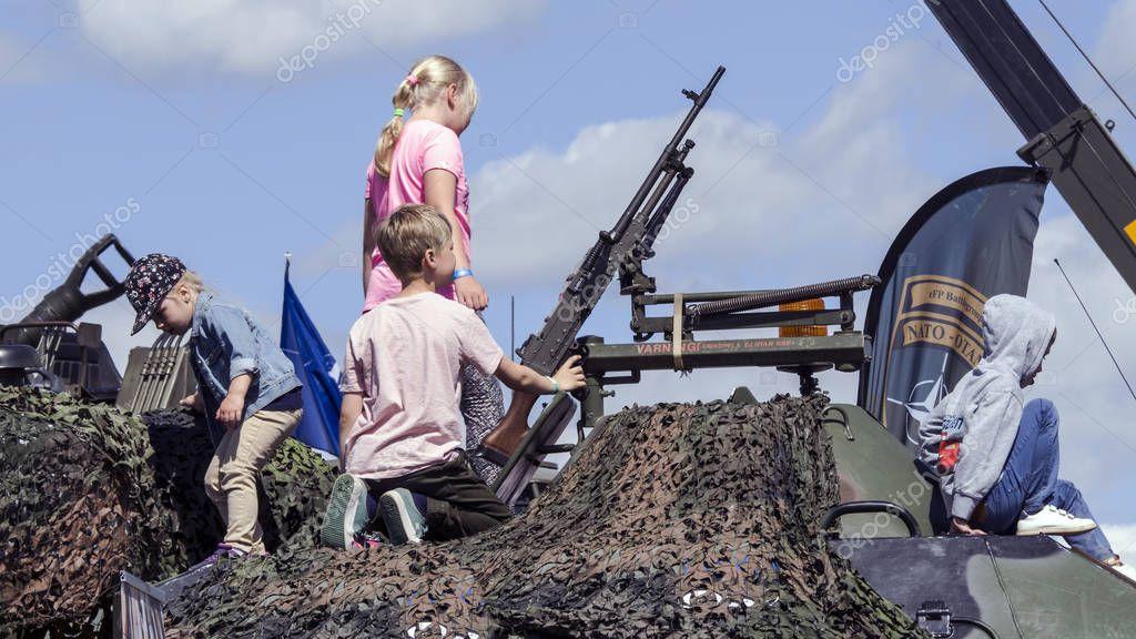 Big Guns and Little Kids
