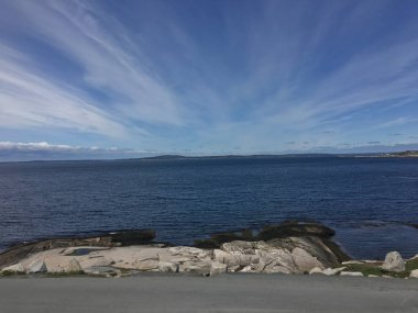 Looking at the ocean and sky at Peggy's Cove in Halifax Nova Scotia, volcanic rock formations and awesome view