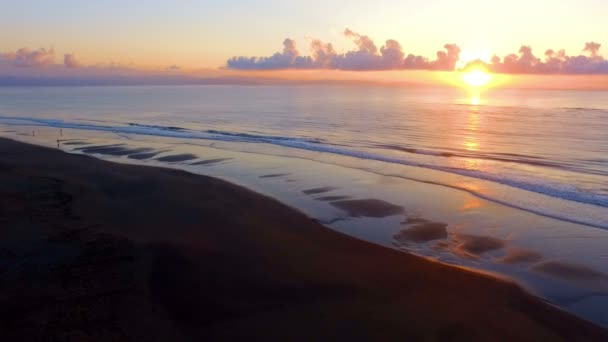 Virgin unspoiled Caribbean beach aerial drone view at sunrise. Golden sun bright light over sandy beaches make up an awesome tropical landscape. Awe low high aerial view. Spectacular colourful background.