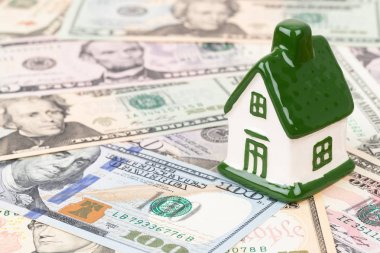 Mini model house on dollar money banknote concept for mortgage,