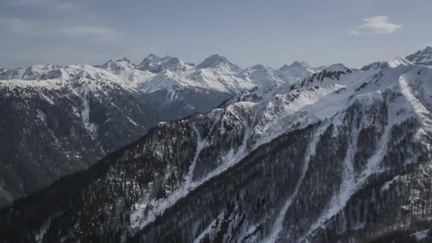 Winter Aerial Amazing Landscape. Snow Covered Mountains. Helicopter Footage