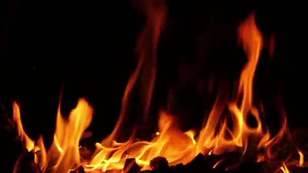 Closeup Of Fire Burning On Black Background In Slow Motion