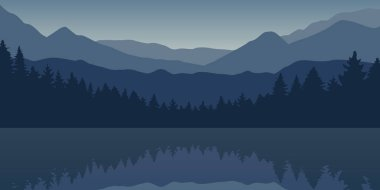 blue forest and mountain nature landscape by the lake