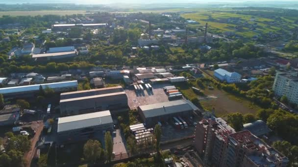 The construction of a modern production building or factory, allocated in countyside area. 4K.