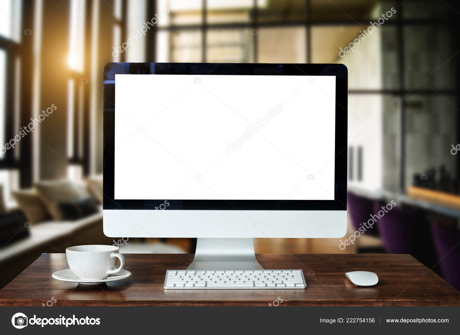 Workspace with computer Monitor, Keyboard, blank screen coffee cup  smartphone, and tablet on a table or White Screen Isolated in bright office  room ...