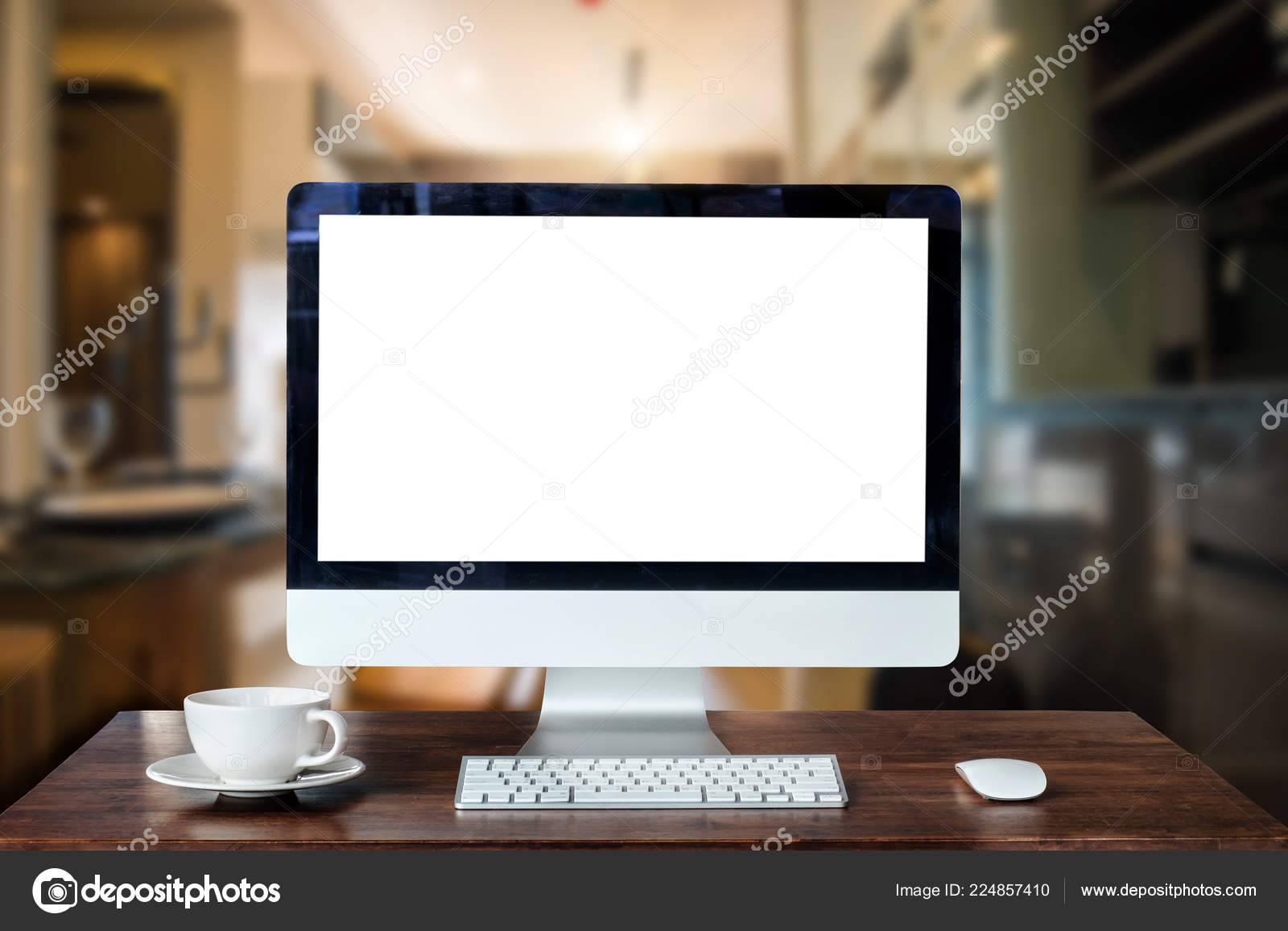 17 Workspace with computer Monitor, Keyboard, blank screen coffee cup  smartphone, and tablet on a table or White Screen Isolated in bright office  room ...
