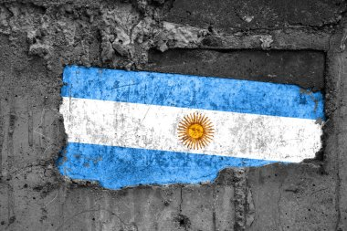 The flag of Argentina on a dirty wooden surface, built into a concrete base, with scuffs and scratches. Loss or destruction conception.
