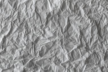 texture of crumpled white paper,texture of paper with kinks and dents, old and dilapidated.