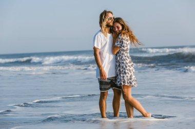 Couple cuddling on ocean beach in bali, indonesia stock vector