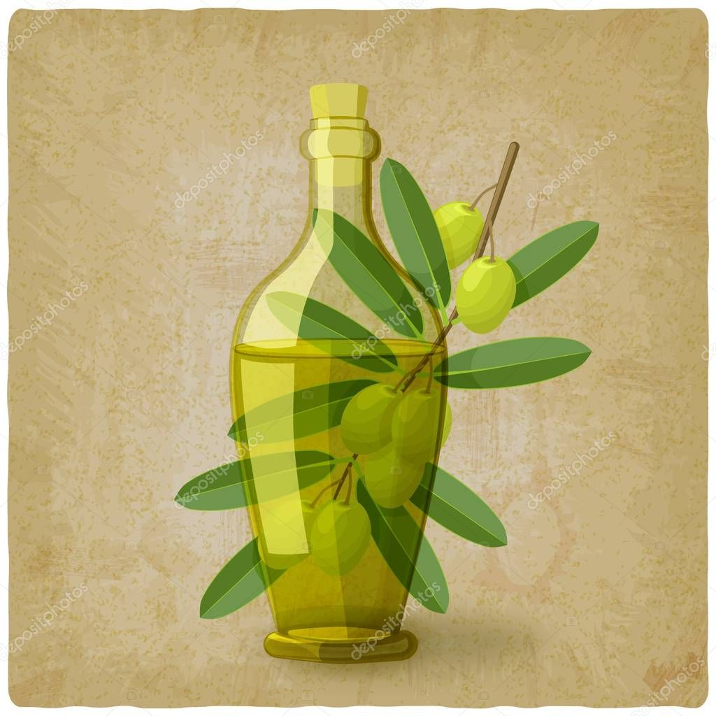 olive branch with bottle of oil