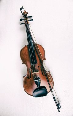 The abstract art design background of wooden violin and bow ,put on white background,in dramatic tone,show body of violin.