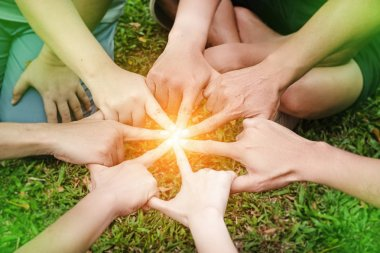 The human hands is touching together,United hands together,expressing positive,sign and symbol of power,teamwork concept,blurry light around