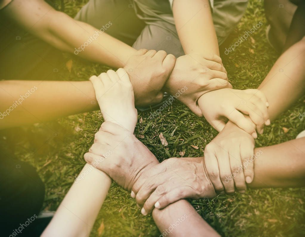 The human hands is touching together,United hands together,expressing positive,teamwork concept