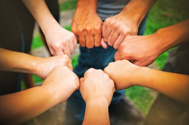 The abstract art design background of human hands touching together,teamwork concept,punching team for power and success