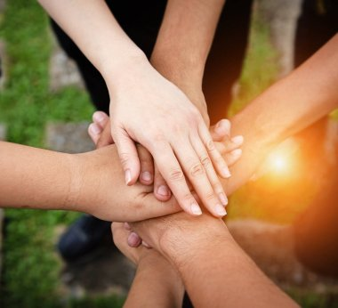 The human hand is touching together,for power and success,teamwork concept