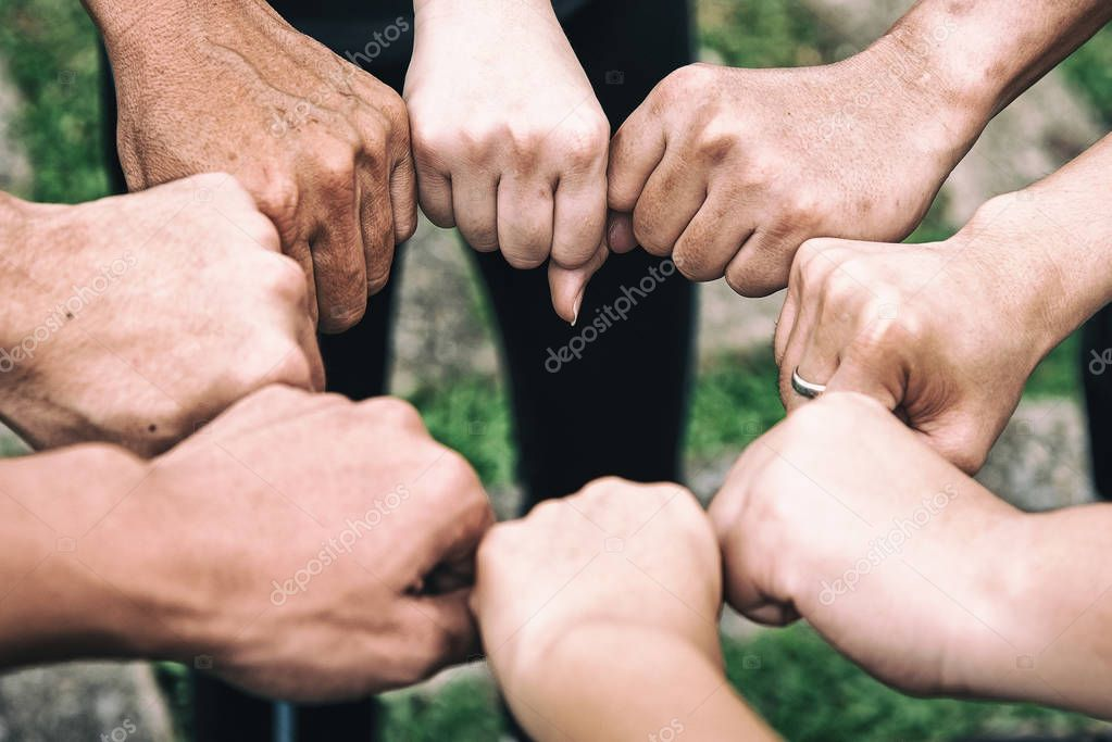The abstract art design background of human hands touching together,power and union,teamwork concept