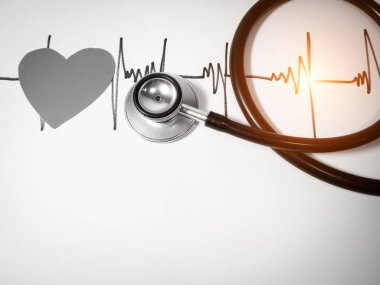 The Stethoscope put on the cardiogram isolate on white.Cardiac t