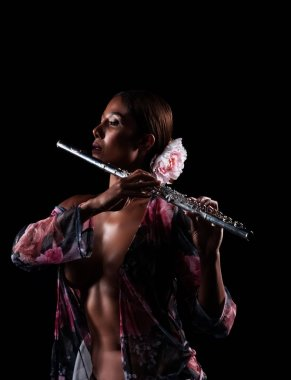 The sexy woman holdidng flute in hand,show beauty shape of body
