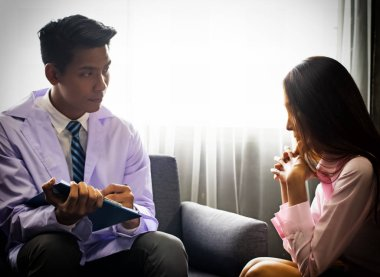 The psychiatrist is conducting a consultation to the stress woman,for treatment plan