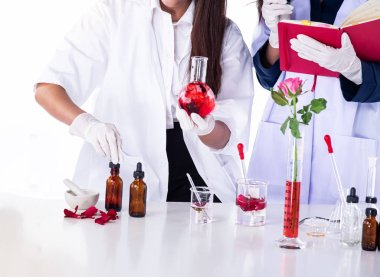 Hands of scientists conducting experiments in laboratory,team of
