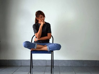Woman sitting on chair,with stress and upset feeling.Have mental problems.The depressive disorder syndrome