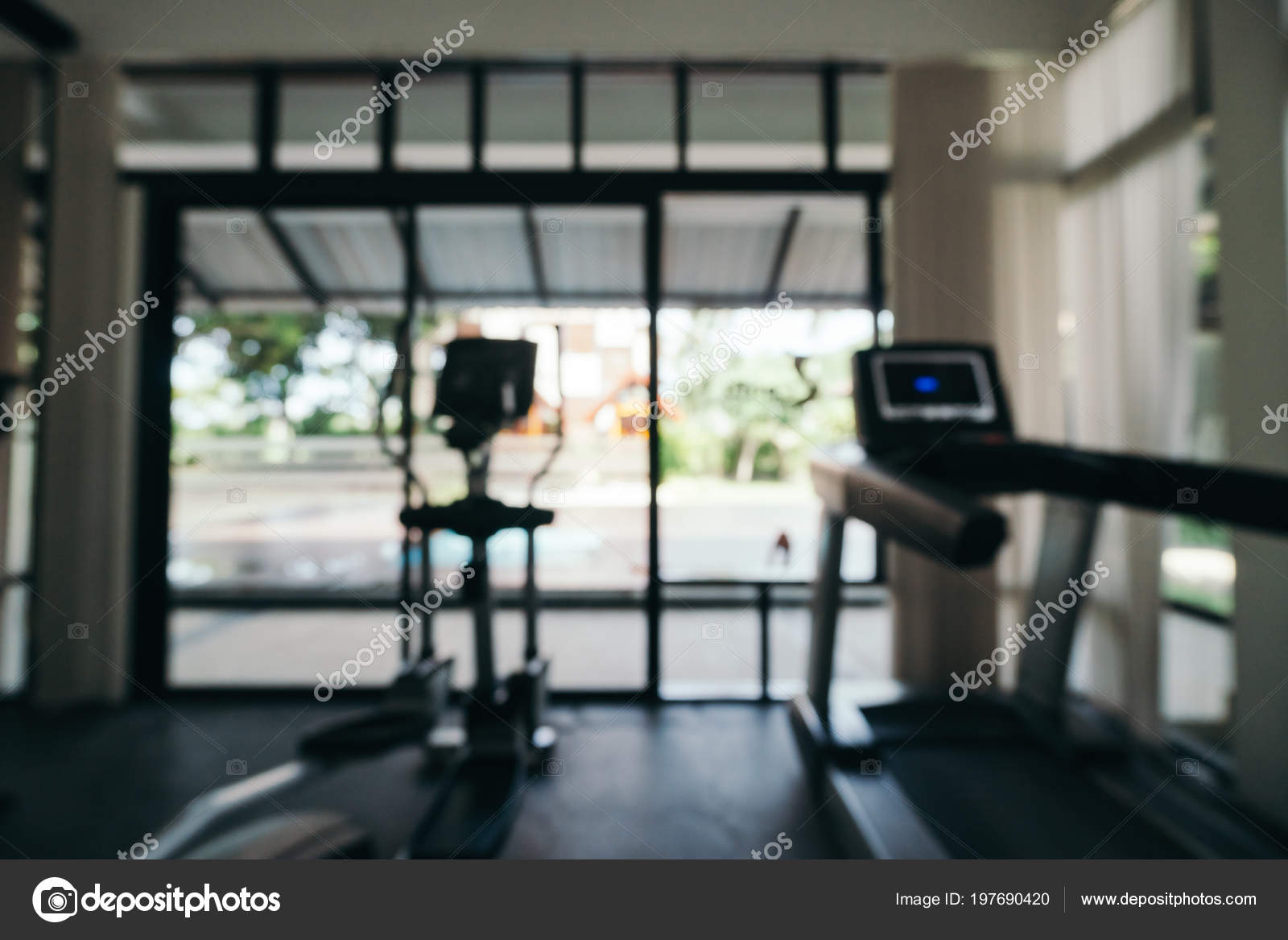 Abstract blur defocused fitness equipment interior gym room