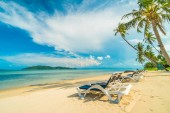 Beautiful tropical beach and sea with coconut palm tree and chair in paradise island