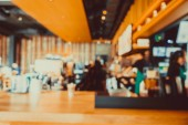Abstract blur and defocused coffee shop cafe and restaurant interior for background - Vintage Filter