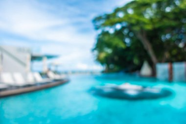 Abstract blur and defocused beautiful outdoor swimming pool in hotel and resort for background
