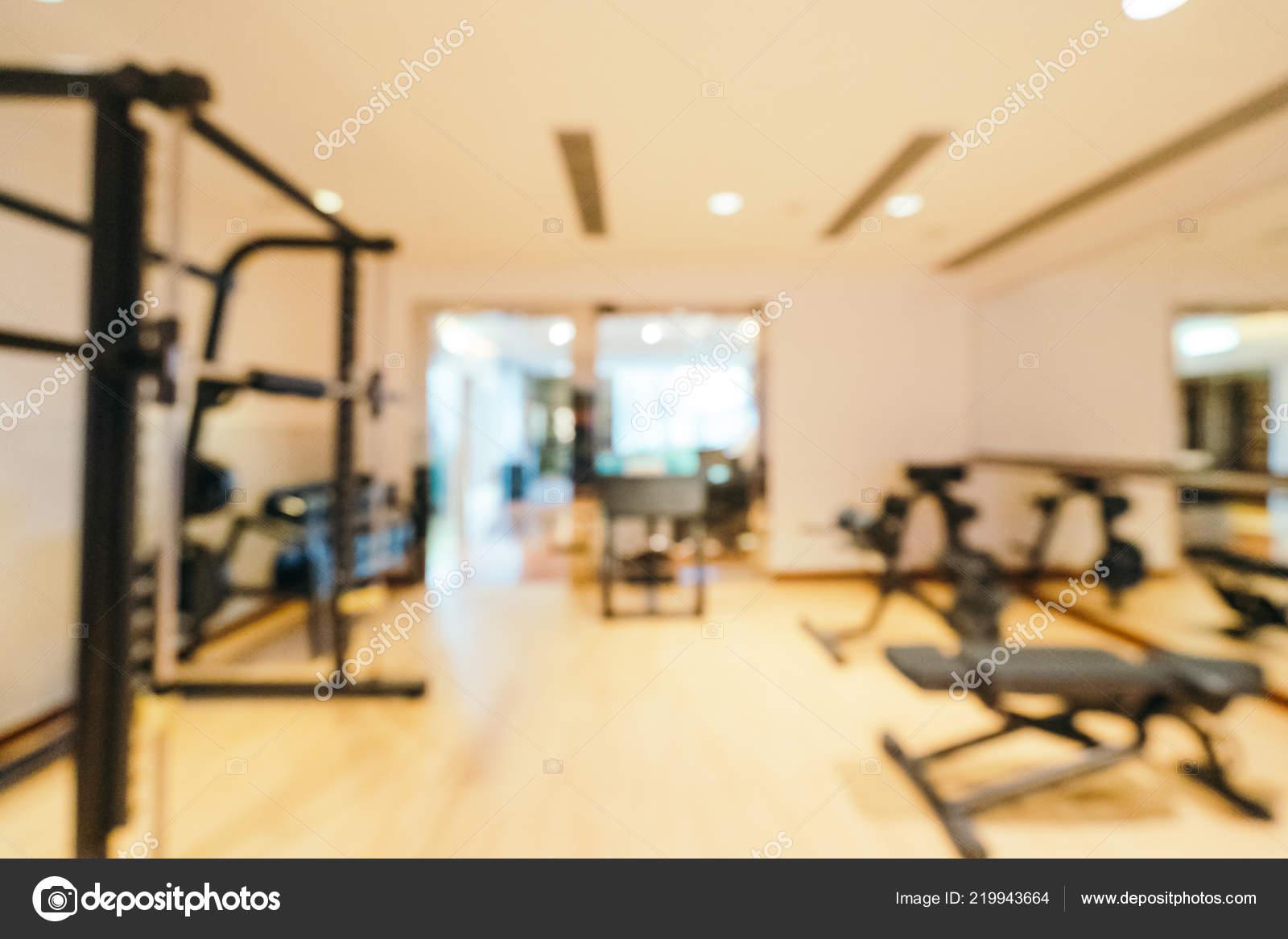 Abstract blur defocused fitness equipment gym room interior