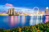 Fotografie Beautiful architecture building skyscraper around marina bay in singapore city at twilight