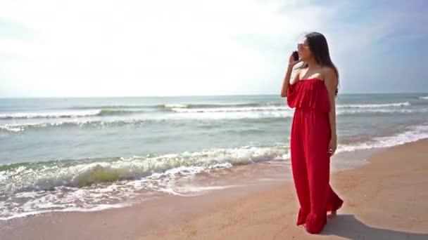 footage  of beautiful asian woman on beautiful seashore