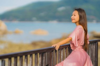 Portrait beautiful young asian woman looking sea beach ocean for