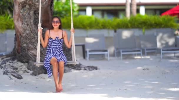 footage of beautiful Asian woman on seashore during summer vacation