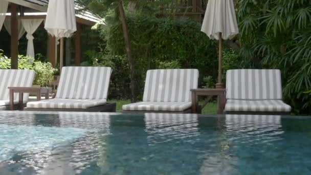 tranquil footage of empty pool at resort hotel