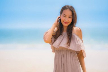 Portrait beautiful young asian woman happy smile relax on the tr