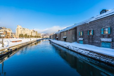 Beautiful landscape and cityscape of Otaru canal river in winter
