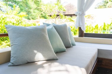 Pillow on sofa chair decoration outdoor patio with garden view
