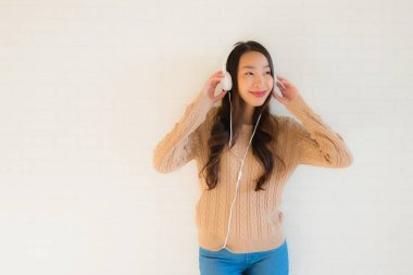 Portrait beautiful young asian women happy enjoy with listen music and copy space