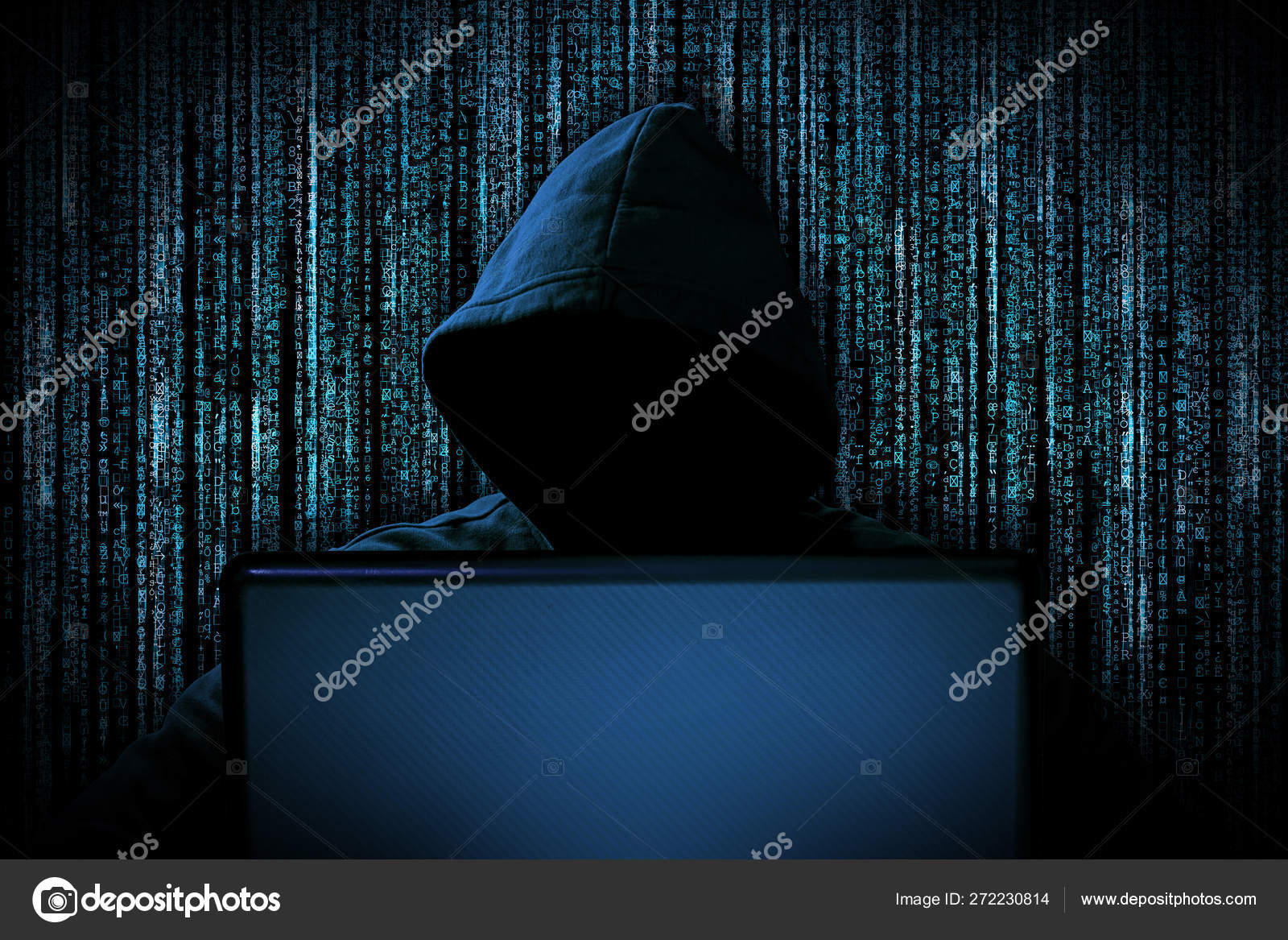 hacker with red glowing mask behind notebook laptop in front of