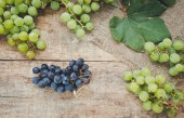 Grapes bunches on a wooden background