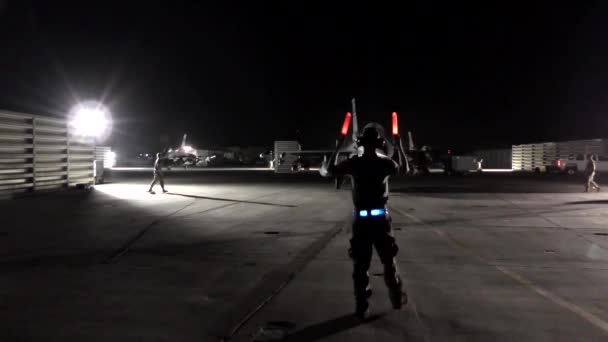 Signalman giving directions to a military jet
