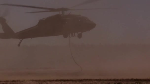 Soldiers Fast-Rope From An Helicopter Flying Over
