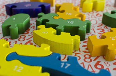 puzzles and colored figures with numbers and letters used in occupational therapy, for rehabilitation or learning