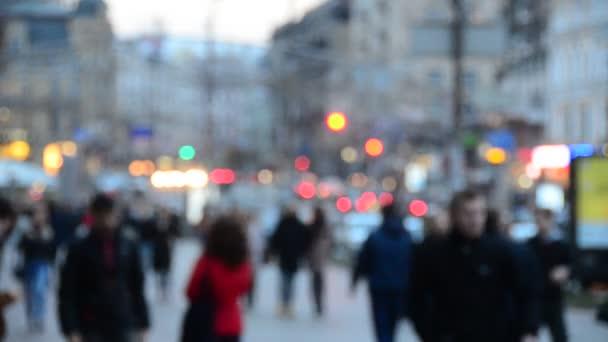 unfocused view of people walking along the central street of Khreschyatik, Kyiv, Ukraine