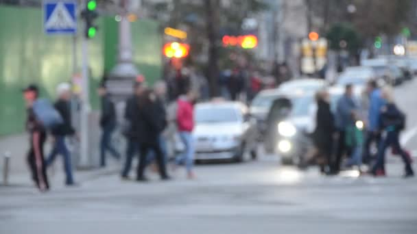 unfocused view of people walking along the central street of Khreschyatik, Kyiv, Ukraine