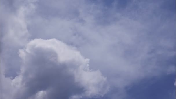 4K Time-lapse motion of puffy fluffy white clouds blue sky background.